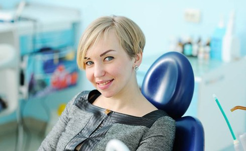 Woman smiling at dentist's office