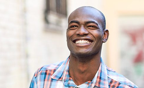 Young man with healthy flawless smile