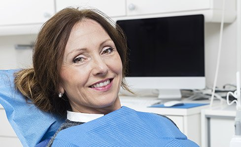 Older woman smiling in dental chair