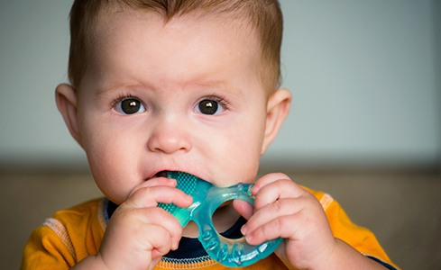 Infant with teething ring
