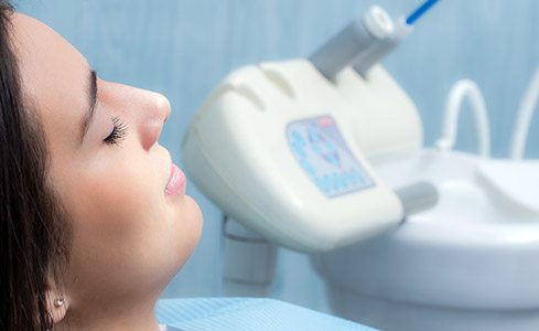 Woman with eyes closed in dental chair