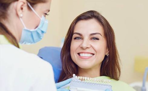 smiling woman with dental crowns