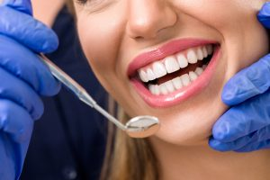 See your dentist in Long Island City at least twice a year to keep your smile healthy.