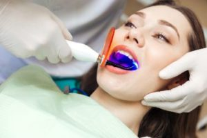 Female patient getting laser dentistry