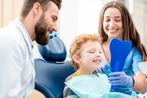 young kid in the dentist chair