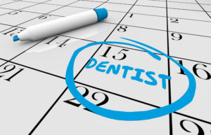 Calendar reminding patient to visit Long Island City dentist