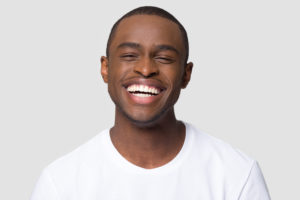 Man with healthy smile thanks to his Long Island City dentist